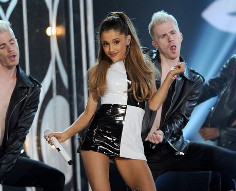 Ariana Grande performs and wearing monochrome