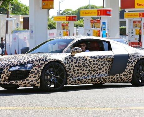 Justin Bieber spotted in LA in leopard print car.