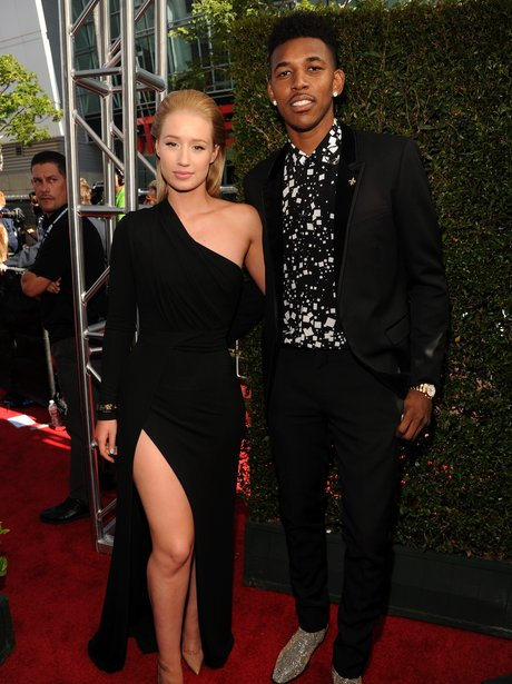 Iggy Azalea (L) and NBA player Nick Young attend T