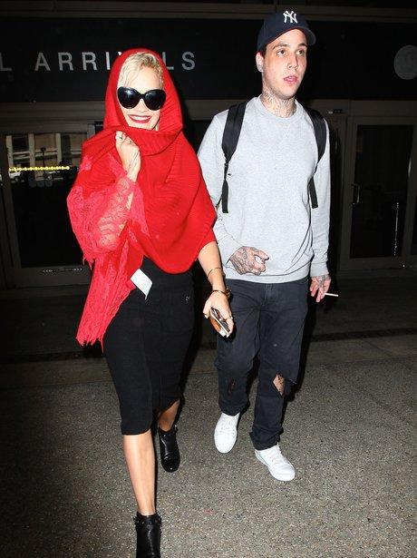 Rita Ora and Rich Hilfiger at the airport