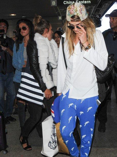 Cara Delevigne and Selena Gomez arrive in LA