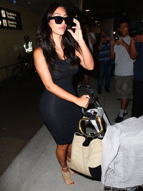 Kim Kardashian wearing a black dress