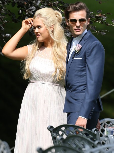 Louis Tomlinson and sister at his mums wedding