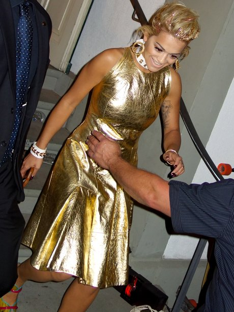Rita Ora wearing a gold outfit