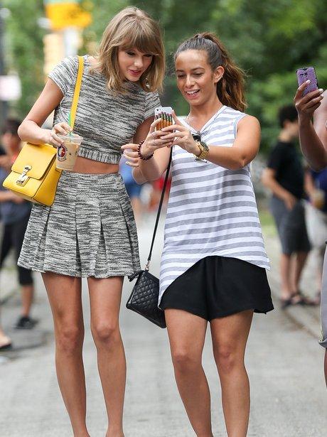Taylor Swift takes a selfie with a fan