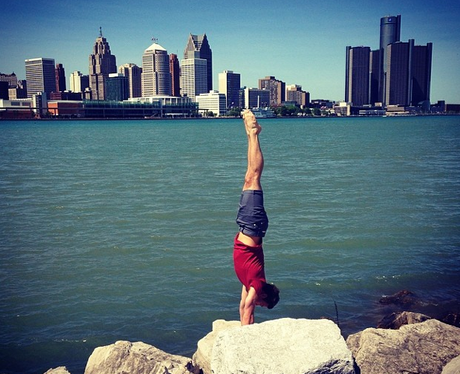 Tom Daley doing a hand stand