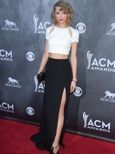 Taylor Swift at ACM Awards in cut out top.