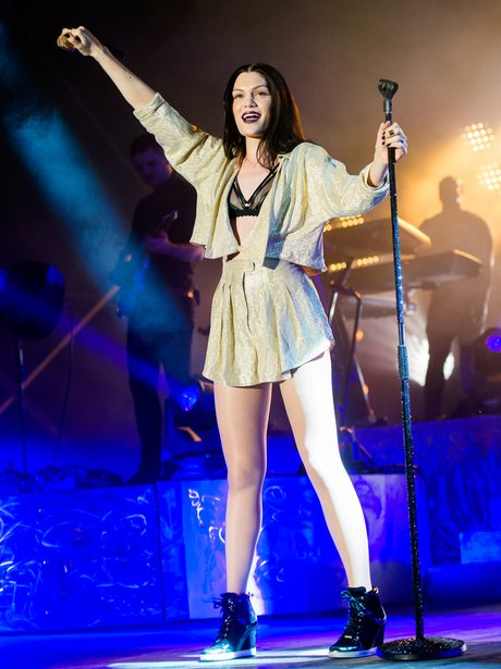 Jessie J performing live in gold shorts and bra