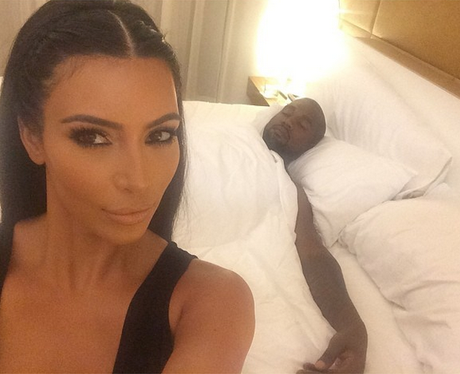 Kim Kardashian West seflie with Kanye sleeping