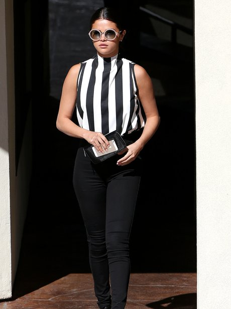 Selena Gomez wearing a stripey outfit