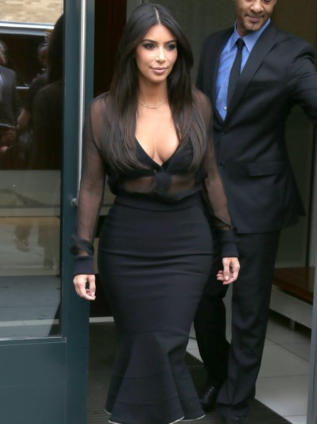 Kim Kardashian wearing a sheer top