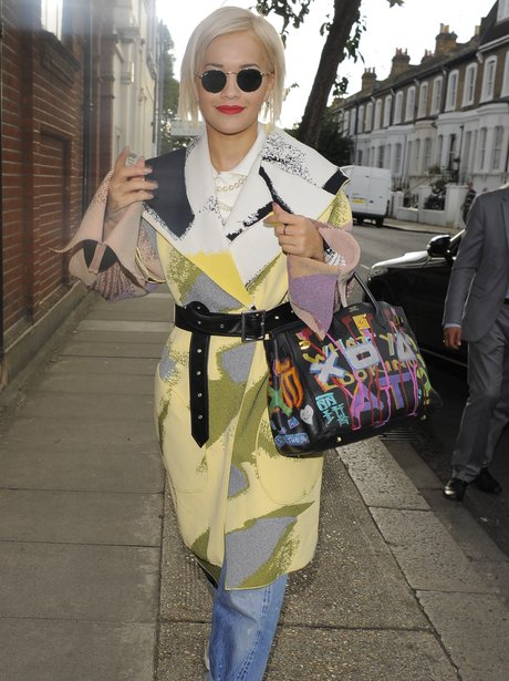 Rita Ora wearing a patterned coat