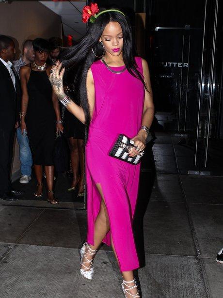 Rihanna wearing a bright pink dress