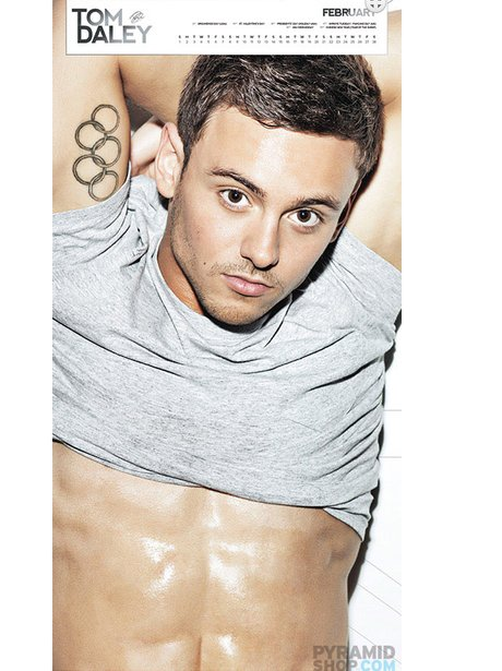 Tom Daley shows off his abs in his 2015 calendar