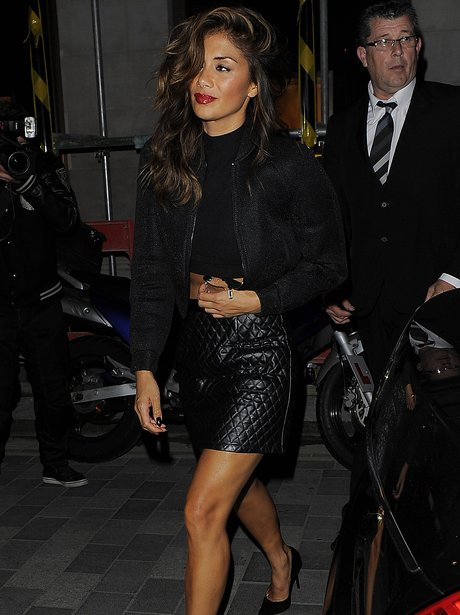 Nicole Scheriznger wearing a leather skirt