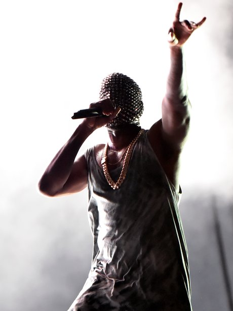 Kanye West wearing a diamond mask