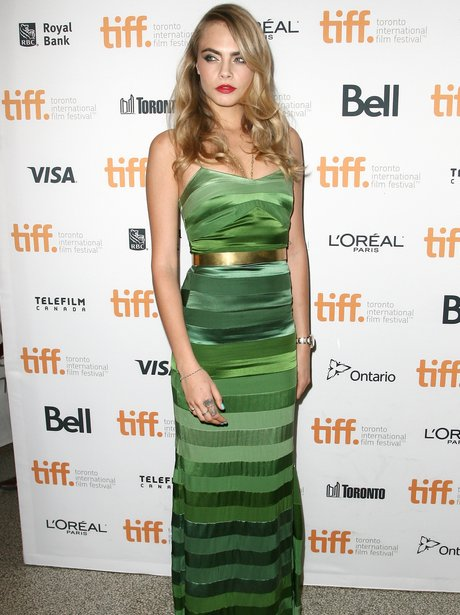 Cara Delevingn wearing a green dress