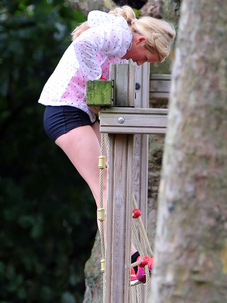 Ellie Goulding working out in a park