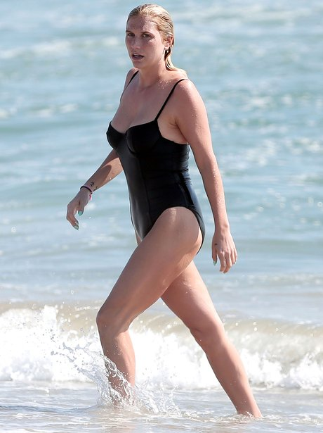 Kesha wearing a black swimsuit on holiday