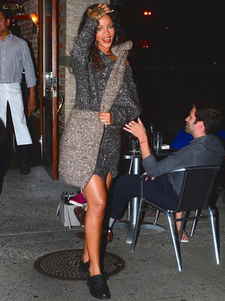 Rihanna wearing a wooly silver dress