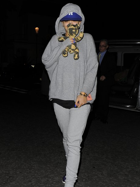 Rita Ora arrives in England holding a  toy bear