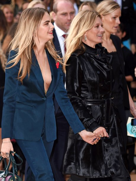 Cara Delevingne and Kate Moss holding hands