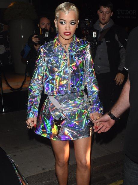 rita Ora is  wearing a luminous jacke