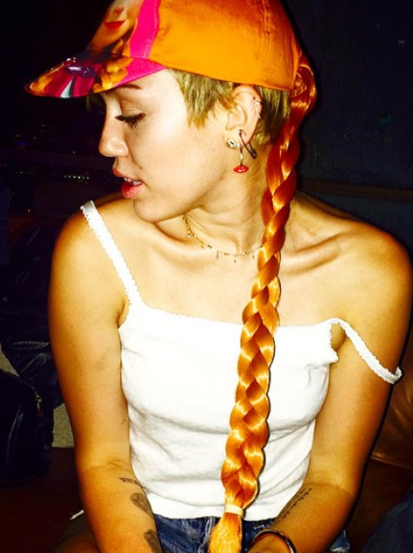 MIley Cyrus  with a pretend plait in her hair