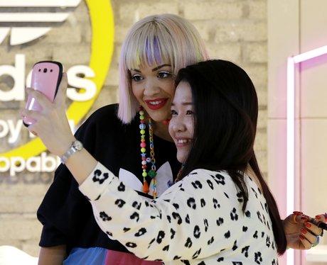 Rita Ora takes a selfie with a fan
