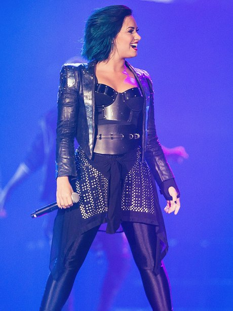 Demi Lovato on stage with blue hair
