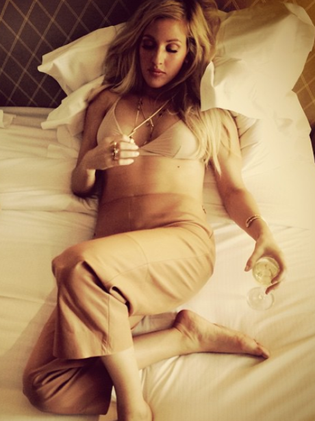 Elliw Goulding lying on her bed in underwear
