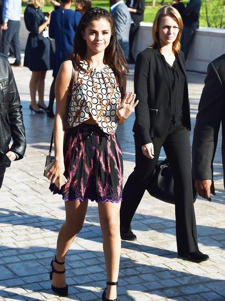 Selena Gomez waving