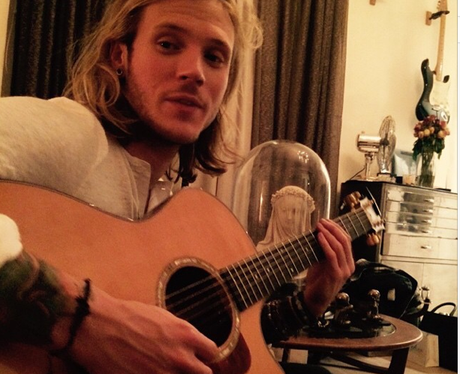 Dougie Poynter playing the giutar