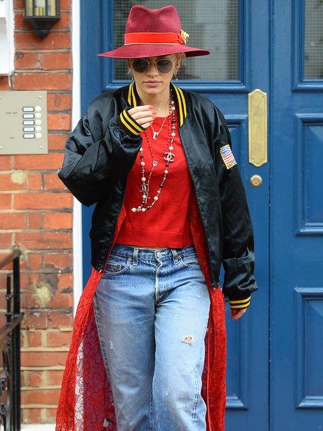Rita Ora wearign a red hat