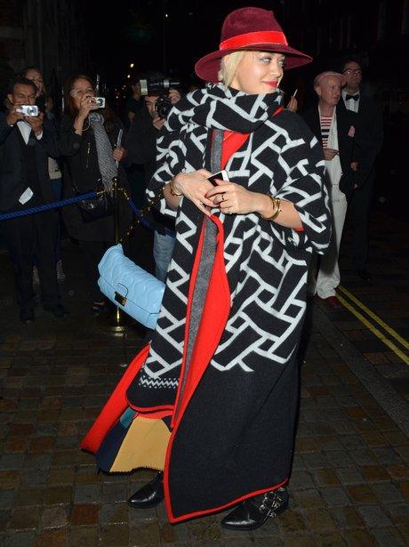 Rita Ora wearing a big coat