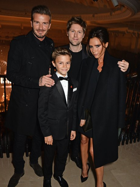 David, Victoria and Romeo Beckham Burberry launch