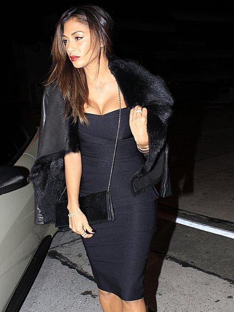Nicole Scherzinger wearing a tight black dress