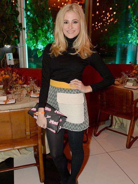 Pixie Lott at event wearing a mini skirt