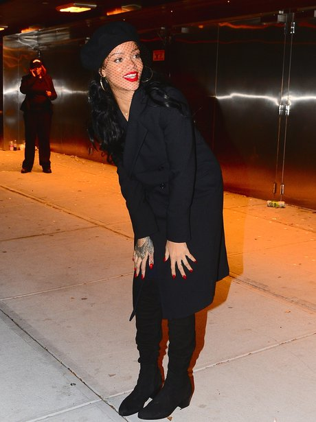 Rihanna wearing a black outfit