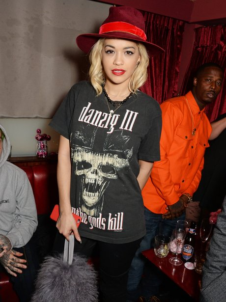 Rita Ora holding a fur bag