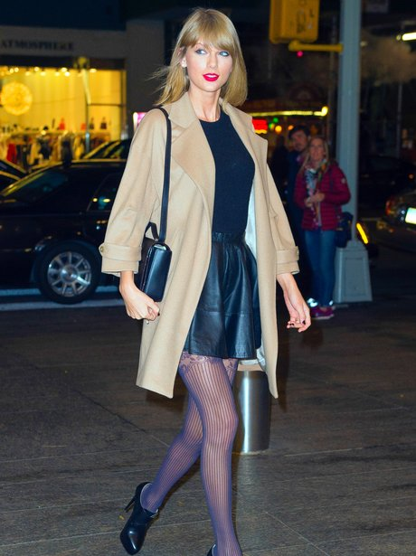 Taylor Swift wearing a leather skirt