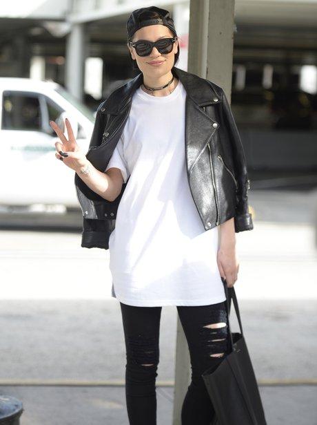 Jessie J wearing a leather jacket