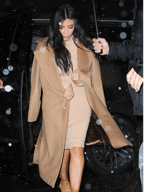 Kim Kardashian waling in the rain