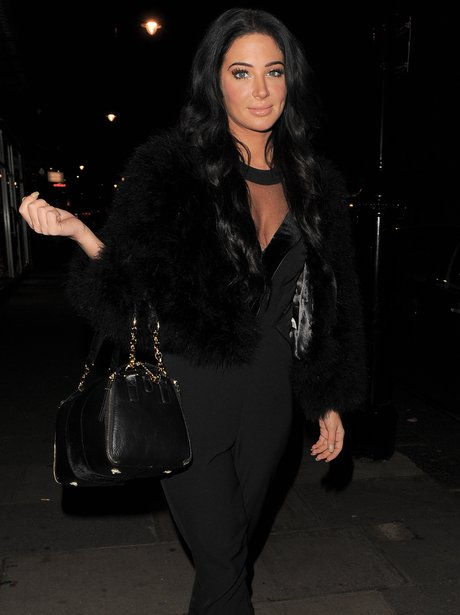 Tulisa wearing a black jumpsuit