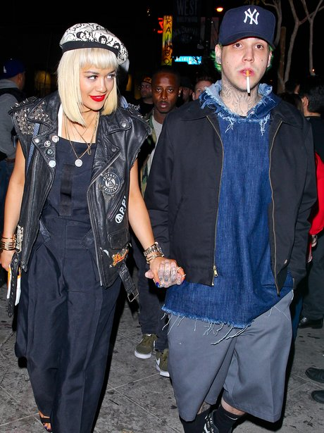 Rita Ora and Ricky Hillfiger holding hands