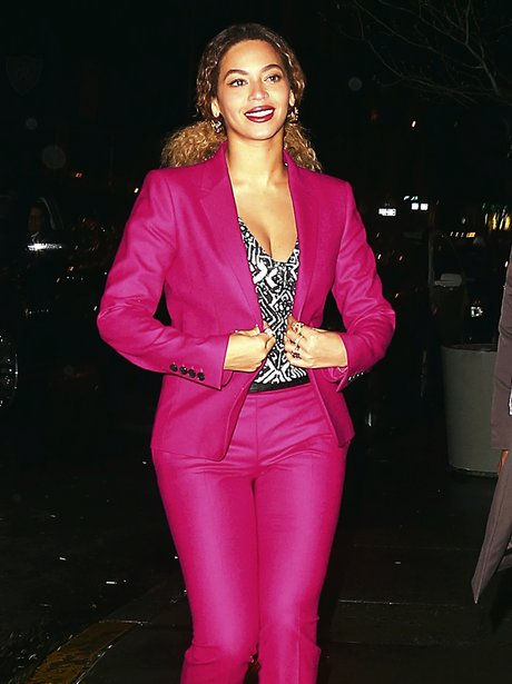 Beyonce wearing a pink suit