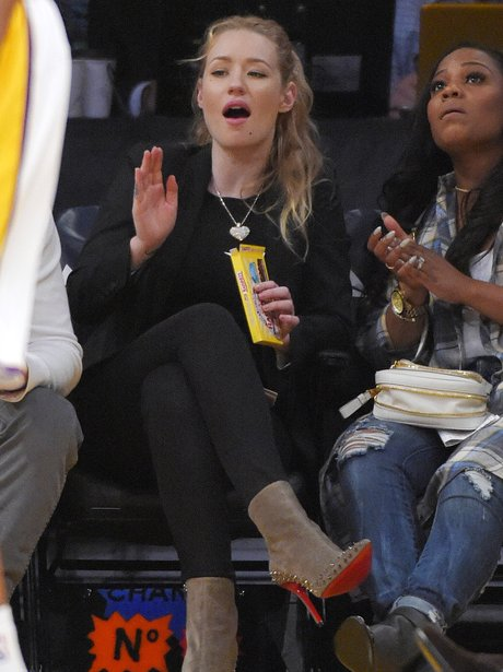 Iggy Azalea watching the basketball
