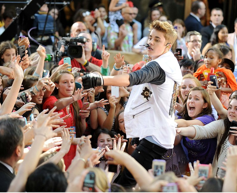 Justin Bieber with fans on stage