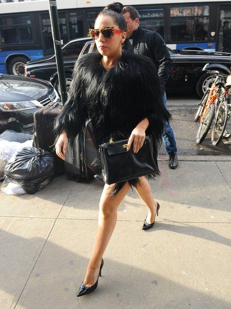 Lady Gaga wearing a black fur coat