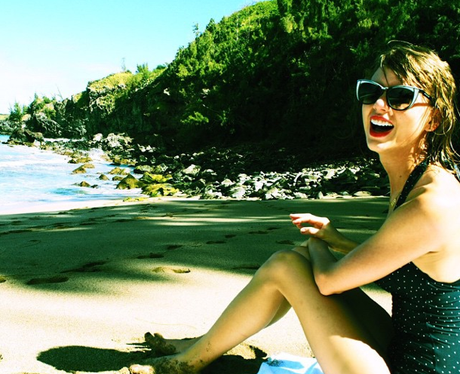 Taylor Swiftw earing a bathing suit on holiday